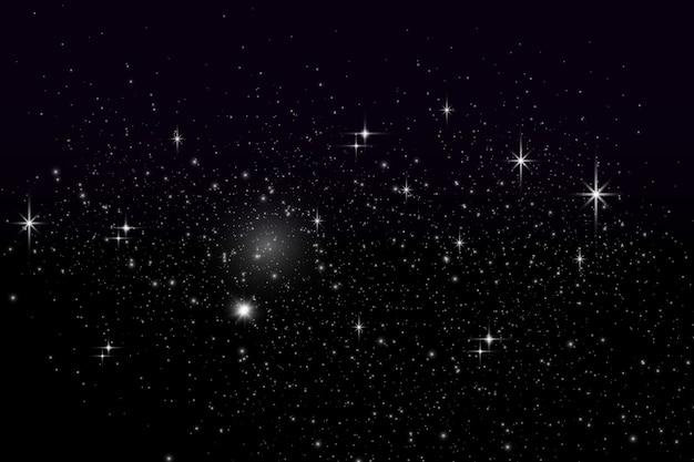 Nocne niebo gwiaździste z gwiazdami odpowiednimi jako tło. gwiazdy, planety i księżyce. sztuka kosmiczna. gwiezdny pył.
