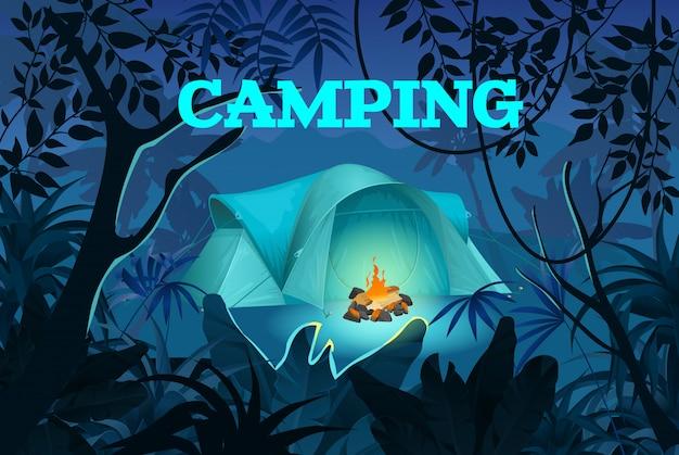 Nocny camping. namiot z ogniskiem w dżungli.
