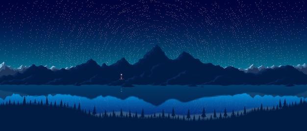 Nocny krajobraz z górami i jeziorem