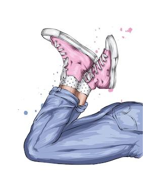Nogi w stylowych dżinsach i trampkach