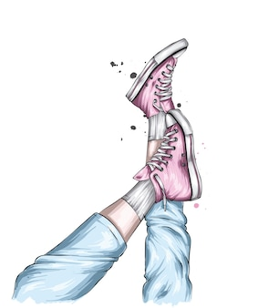 Nogi w stylowych trampkach i dżinsach