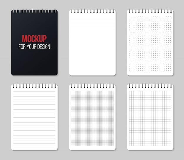 Notebooki wyłożone i kropki papieru puste strony makieta.