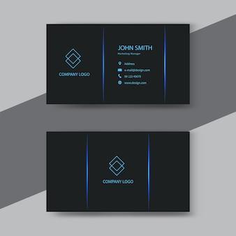 Nowoczesna czarno-niebieska wizytówka.