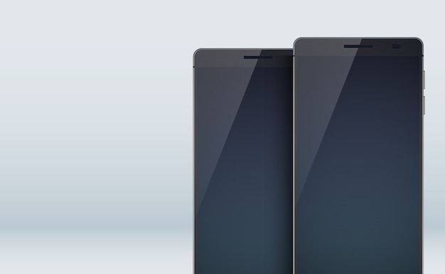 Nowoczesna kolekcja koncepcyjna obejmująca dwa stylowe czarne smartfony z cieniami na dużych pustych wyświetlaczach i ekranach dotykowych w kolorze szarym
