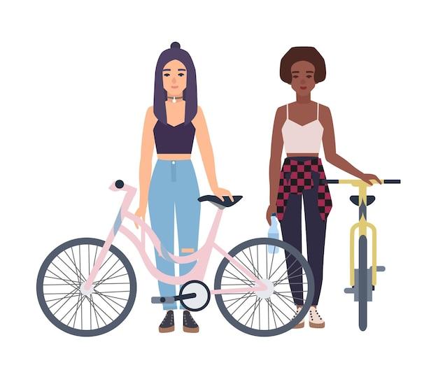 Nowoczesne dziewczyny stojące z rowerami. płaski kolorowy wektor ilustracja kreskówka.