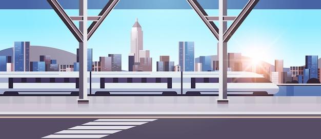 Nowoczesne miasto z wieżowcami i kolejką jednotorową na moście smart city
