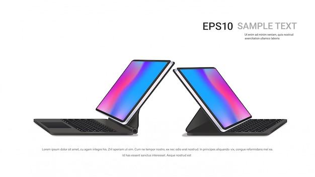 Nowoczesne tablety z klawiaturą i kolorowymi ekranami na realistycznych urządzeniach białej ściany