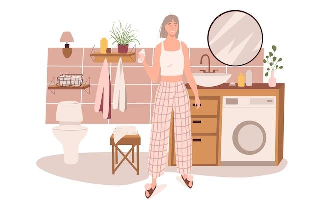 Nowoczesne wygodne wnętrze koncepcji sieciowej łazienki. kobieta robi rutynę kosmetyczną w pokoju z umywalką, lustrem, toaletą, wystrojem domu