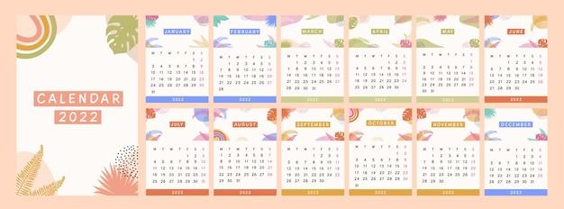 Nowoczesny kalendarz 2022 roku. tropikalny streszczenie planner z jasnymi kolorowymi ręcznie rysowane egzotyczne rośliny w stylu cyganerii. minimalistyczne abstrakcyjne elementy liści do stron pamiętnika. płaskie ilustracji wektorowych.