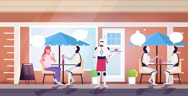 Nowoczesny robot-kelner serwujący słodkie ciasto dla klientów siedzących przy stołach