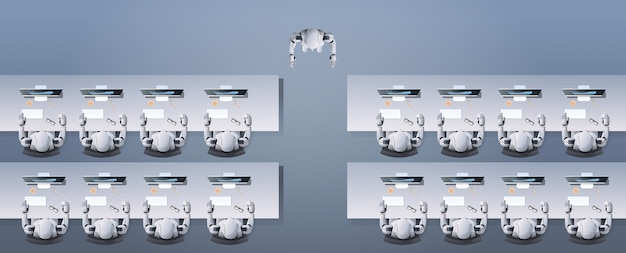 Nowoczesny robot uczący humanoidalnych robotów siedzących przy biurkach w klasie robotów szkolnych sztucznych