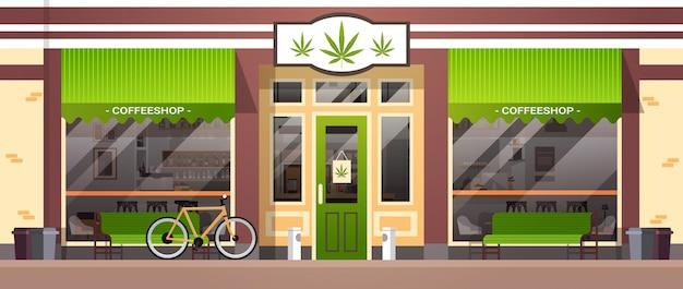 Nowoczesny sklep z marihuaną marihuana organiczny budynek budynek widok z przodu produkty cbd chwasty zakup kawiarnia kawa ulica na zewnątrz poziome