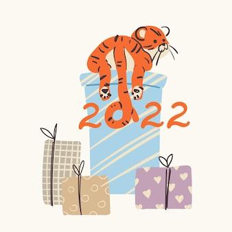 Noworoczny słodki tygrys z prezentami. ręcznie rysowane ilustracja na boże narodzenie