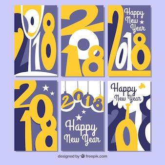 Nowy rok 2018 kartki z żółtymi cyframi