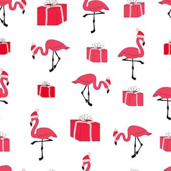 Nowy rok boże narodzenie bezszwowe wzór z flamingami i prezentami płaskie kreskówka różowy czerwony flaming