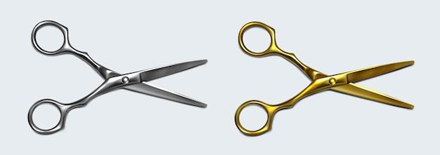 Nożyczki ze srebrnego i złotego metalu z otwartymi ostrzami, widok z góry