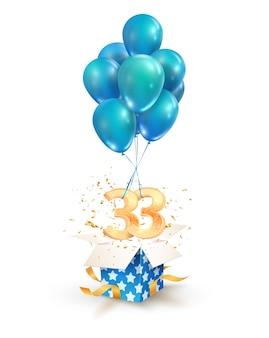 Obchody trzydziestu trzech lat pozdrowienia z urodzin izolowanych elementów projektu. otwórz teksturowane pudełko z numerami i latającymi balonami