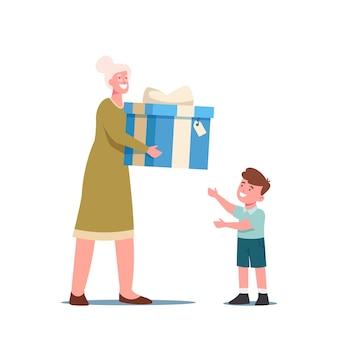 Obchody urodzin dziecka. babcia przygotowała prezent niespodziankę dla małego wnuczka. toddler boy take present od babci, trzymając owinięte pudełko na białym tle. ilustracja kreskówka wektor