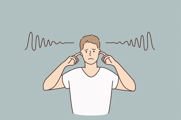 Obejmujące uszy i ciszy koncepcja. postać z kreskówki młody smutny zirytowany mężczyzna stojący zakrywający uszy palcami bez dźwięków wewnątrz ilustracji wektorowych