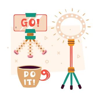 Obiekty clipart blogger. smartfon ze statywem, błyskawicą, filiżanką kawy z moto zrób to! robienie wideo w studio. produkcja treści medialnych. płaskie ilustracja, zestaw na białym tle