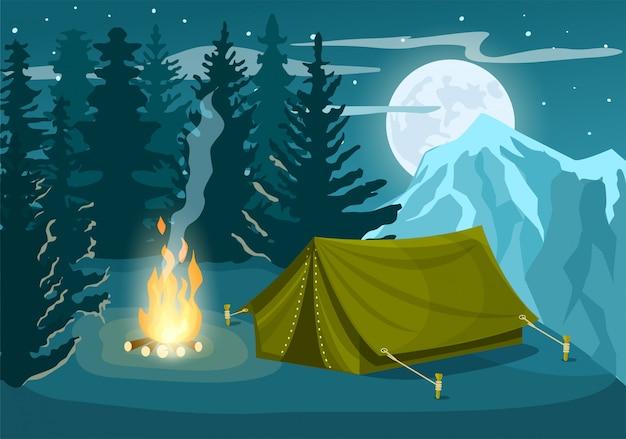Obóz turystyczny w zimowym lesie