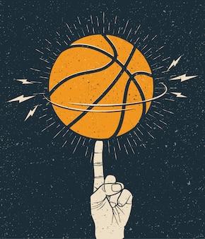 Obracająca pomarańczowa piłka do koszykówki na palcu.