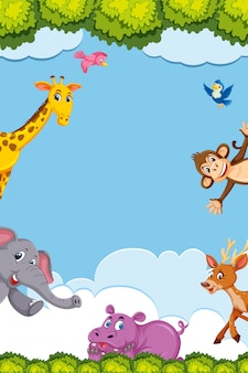 Obramowanie szablonu z wieloma dzikimi zwierzętami