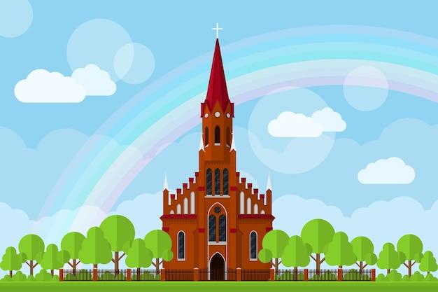 Obraz kościoła rzymskokatolickiego z ogrodzeniem, drzewami, chmurami i tęczą, ilustracja styl