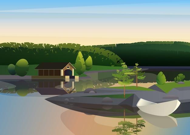 Obraz spokojnego krajobrazu ze zdalną stacją dokującą i żaglówką na brzegu jeziora w zieleni