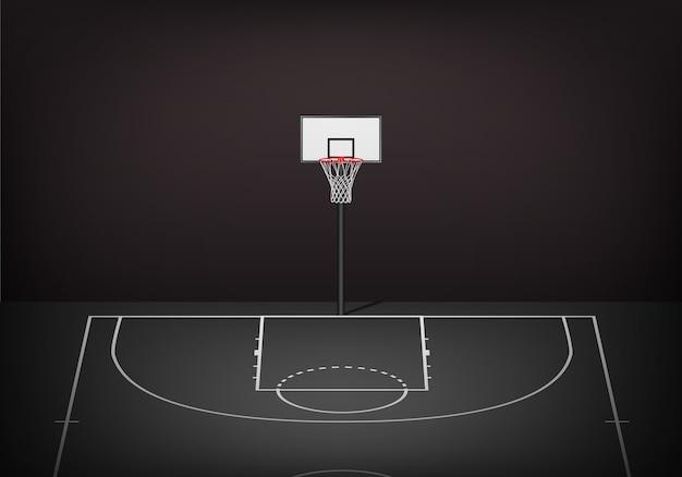 Obręcz do koszykówki na pustym czarnym korcie.