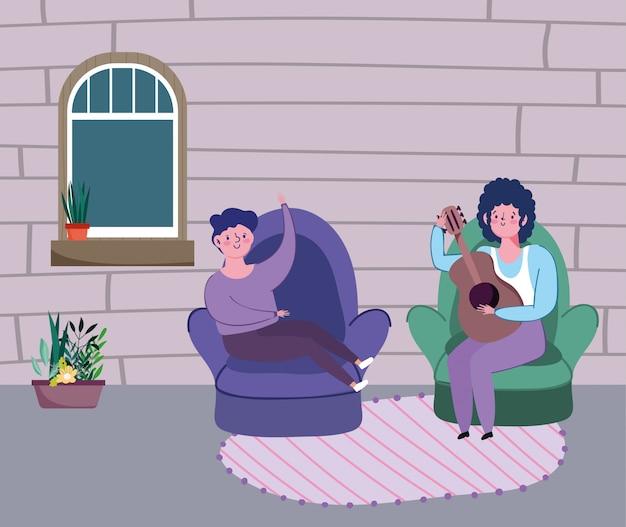 Obsługuje bawić się gitarę i chłopiec siedzi na krześle, kwarantanna zostaje w domu