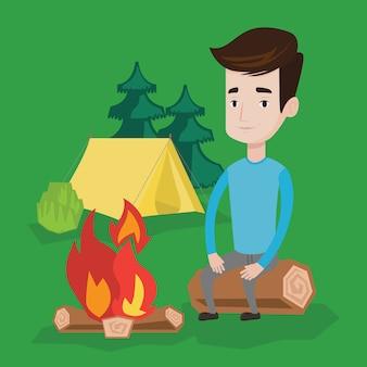 Obsługuje obsiadanie na beli blisko ogniska w campingu.