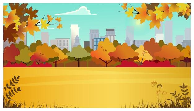 Obszar podmiejski z łąką, drzewami jesiennymi i budynkami miejskimi
