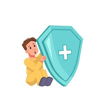 Ochrona przed zakażeniem koronawirusem, dziecko siedzące z tarczą medyczną izolowane dziecko płci męskiej.
