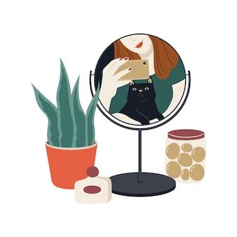 Odbicie czarnego kota w lustrze. szczęśliwy właściciel zwierzaka. selfie dziewczyna trzymająca smartfon