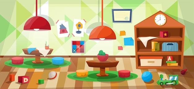 Oddział przedszkolny bez dzieci ze stolikami i zabawkami