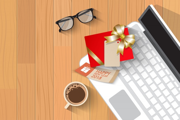 Odgórny widok bożych narodzeń prezent nad laptopem