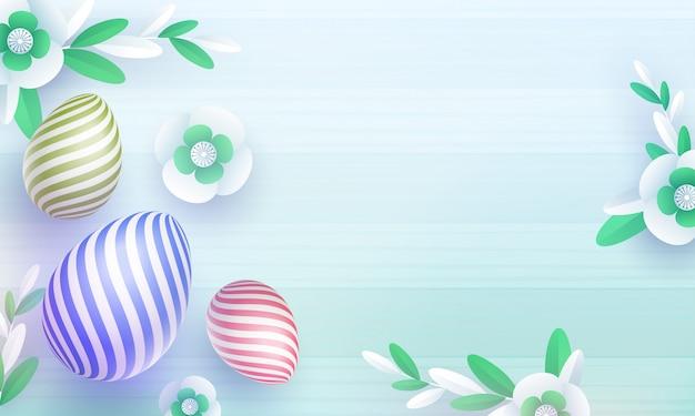Odgórny widok kolorowi easter jajka i tapetuje rżniętych kwiaty