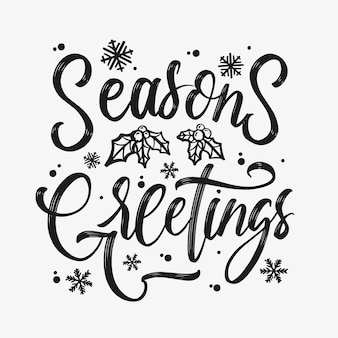 """Odręczny napis """"seasons greetings"""". zimowe wakacje pozdrowienia typografia."""