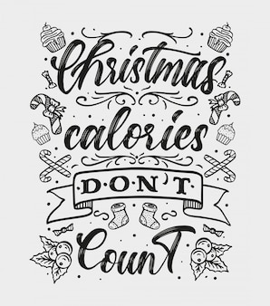 """Odręczny napis """"świąteczne kalorie się nie liczą"""". zimowe wakacje pozdrowienia typografia."""
