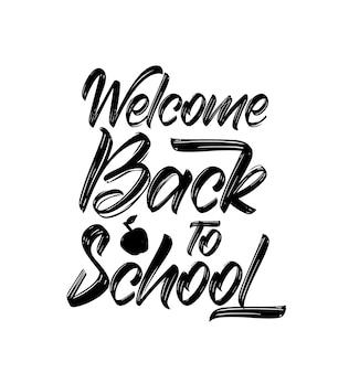 Odręczny pędzelek z napisem welcome back to school.