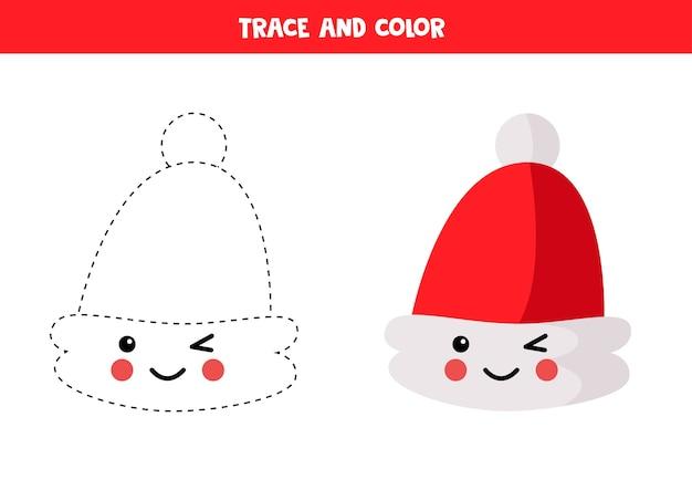 Odrysuj i pokoloruj uroczy kawaii czapkę świętego mikołaja. arkusz edukacyjny. ćwiczenia pisma ręcznego dla dzieci.