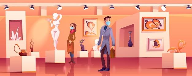 Odwiedzający noszą maski medyczne w muzeum z nowoczesnymi dziełami sztuki