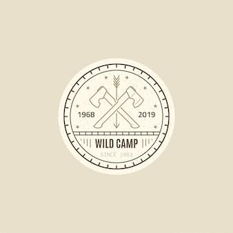Odznaka dzikiego obozu. dwie skrzyżowane topory. przetrwanie dzikiego lasu. czarno-biała ilustracja styl linii.