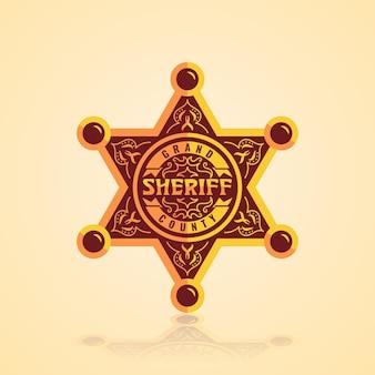 Odznaka gwiazdy szeryfa ze złotymi ornamentami w wielkim hrabstwie texas