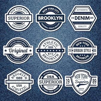Odznaki graficzne jeansy. kurtka patch godło haft vintage kolegium pieczęć lekkoatletyka styl miejski wektor zestaw. ilustracyjna odznaka odzieżowa, odzież dżinsowa