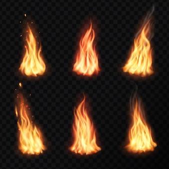 Ogień, płomień pochodni ogniska. płonące ognisko świeci na pomarańczowo i żółto z efektem płomienia z iskier, latających cząstek, żaru i pary. zestaw realistycznych języczków zapłonowych