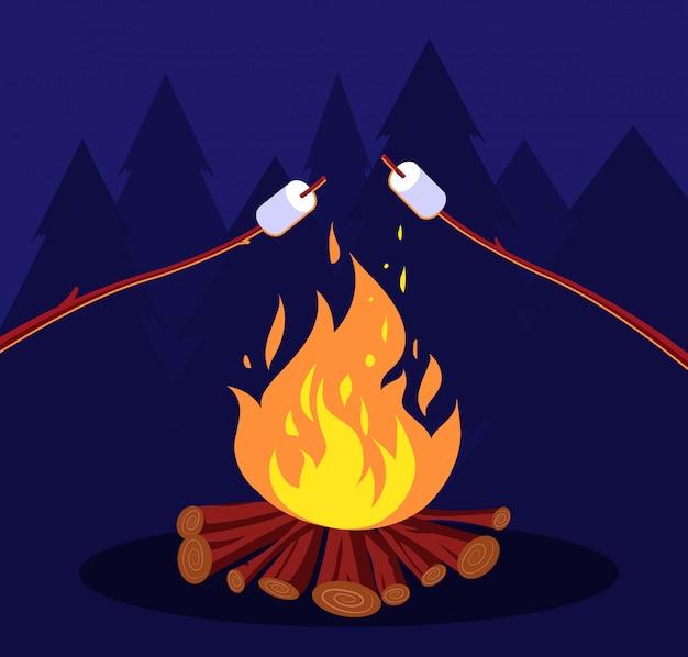 Ognisko i ptasie mleczko. przyjaciele w nocy biwakować przy ognisku. koncepcja marshmallow