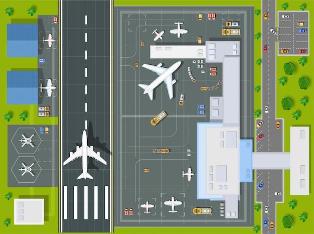 Ogólny widok lotniska ze wszystkimi budynkami, samolotami, pojazdami i lotniskiem