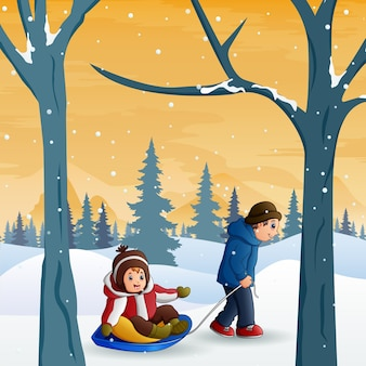 Ojciec ciągnie syna na sankach zimą